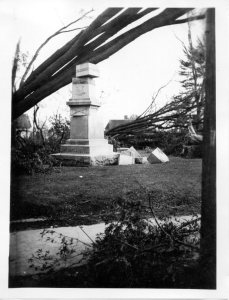 Grave monument damaged by a fallen tree after the Connecticut hurricane of 9/21/1938.