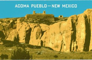 "The back of this vintage postcard says, ""Acoma Pueblo is situated...on an elevated island of rock 357 feet high."""
