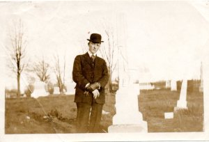 "The back of the photo reads, ""Here is the picture of Hiram on Jesse James grave. My picture was no good so I did not get any of these. But this is a good resemblance of old Hi. And the old Tomb Stone also."""