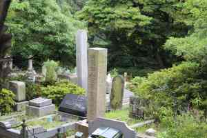 The cemetery holds a mixture of Western-style and Japanese monuments.